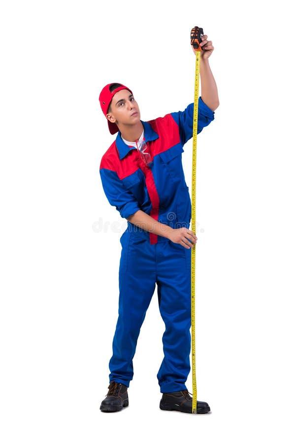 Młody repairman z taśmy miarą odizolowywającą na bielu zdjęcie stock
