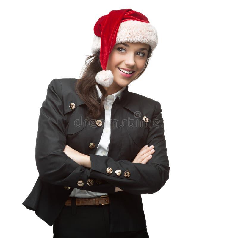 Młody rozochocony bizneswoman w Santa kapeluszowej pozyci odizolowywającej na w fotografia stock
