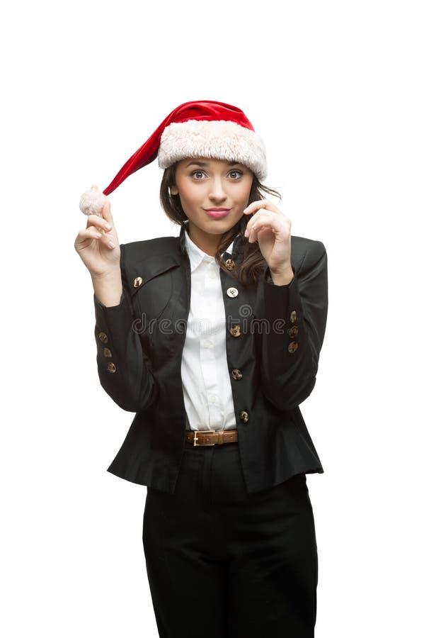 Młody rozochocony bizneswoman w Santa kapeluszu na biel zdjęcie royalty free