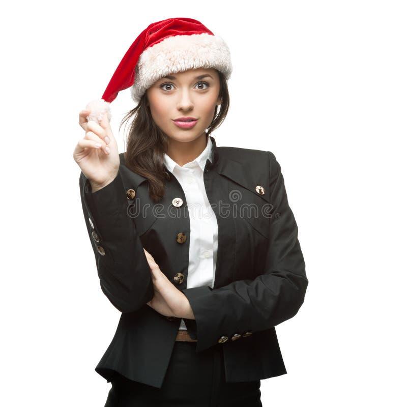 Młody rozochocony bizneswoman w Santa kapeluszu na biel obraz royalty free