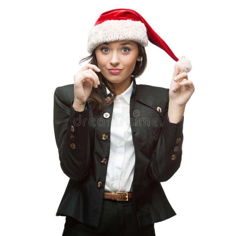 Młody rozochocony bizneswoman w Santa kapeluszu na biel zdjęcia stock