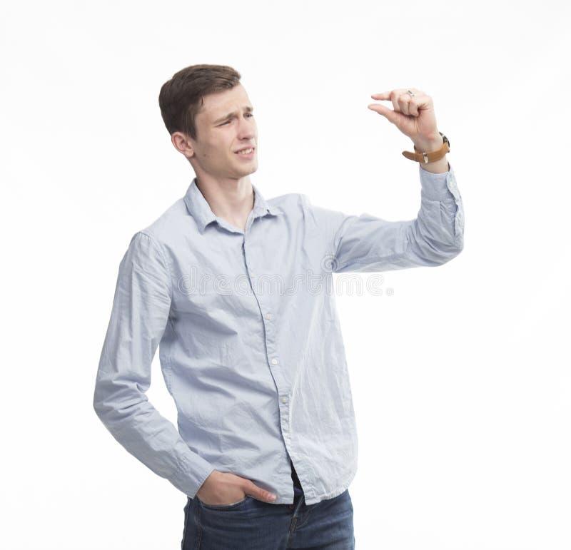 Młody seksowny mężczyzna pokazuje wzrost zdjęcie stock