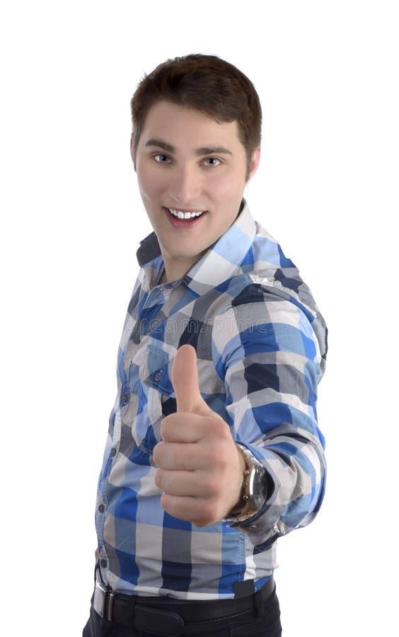 Młody smilling mężczyzna w błękitnej koszula, kciuk up fotografia stock
