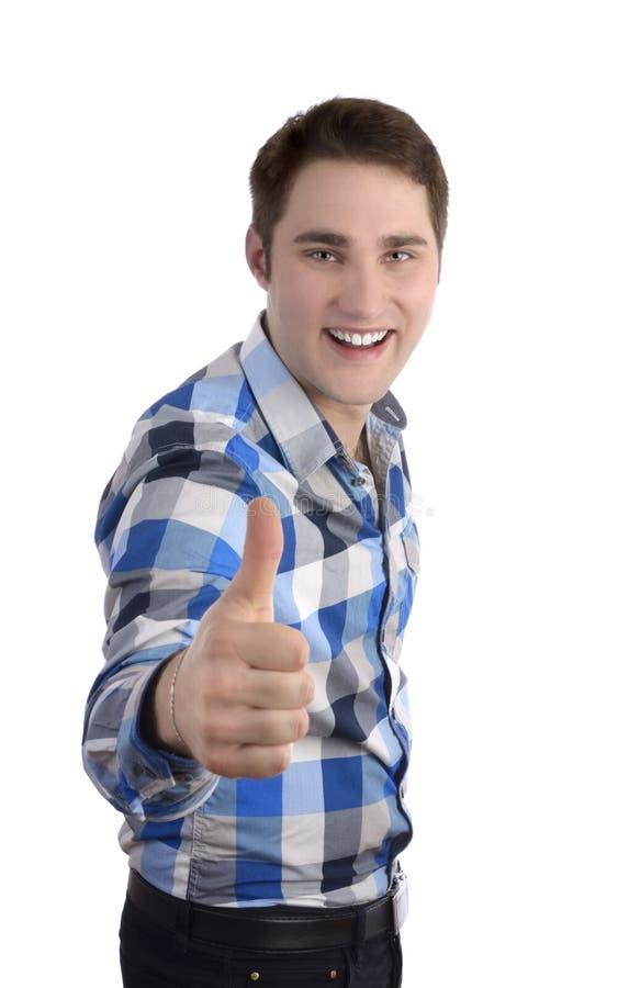 Młody smilling mężczyzna w błękitnej koszula, kciuk up obrazy stock