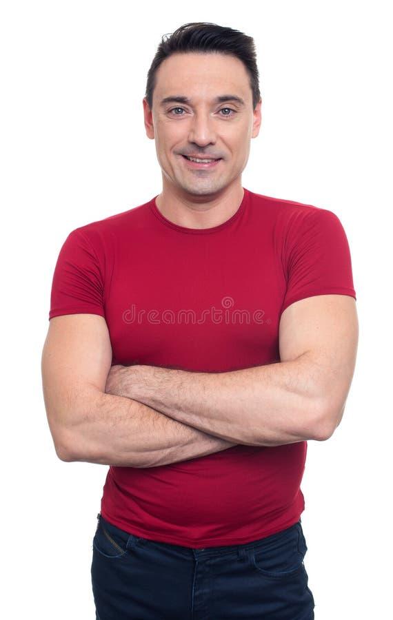 Młody sprawność fizyczna mężczyzna ono uśmiecha się odosobniony obraz stock