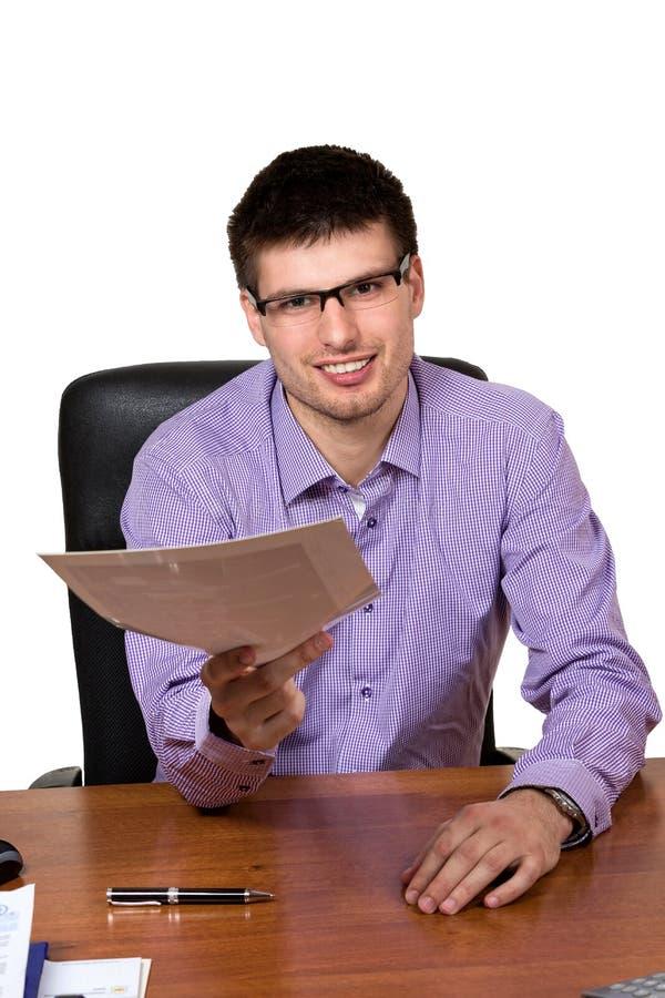 Młody szczęśliwy biznesmen daje dokumentowi obraz royalty free