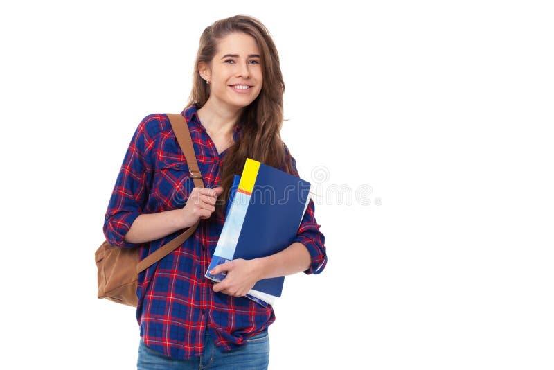 Młody szczęśliwy uczeń z książkami odizolowywać obraz stock