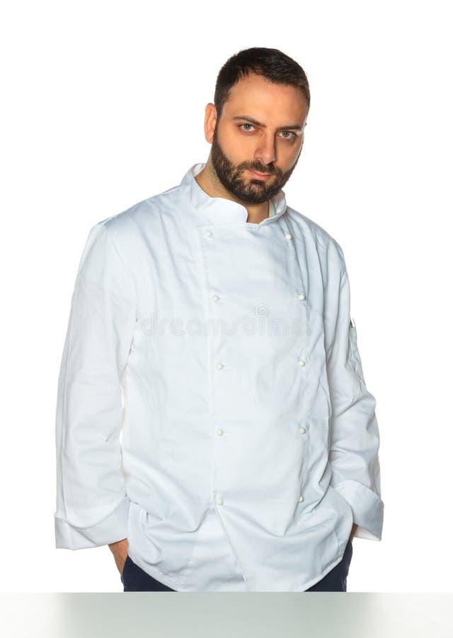 Młody szef kuchni na białym tle zdjęcie royalty free