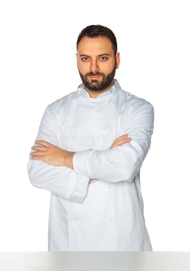 Młody szef kuchni na białym tle zdjęcia royalty free