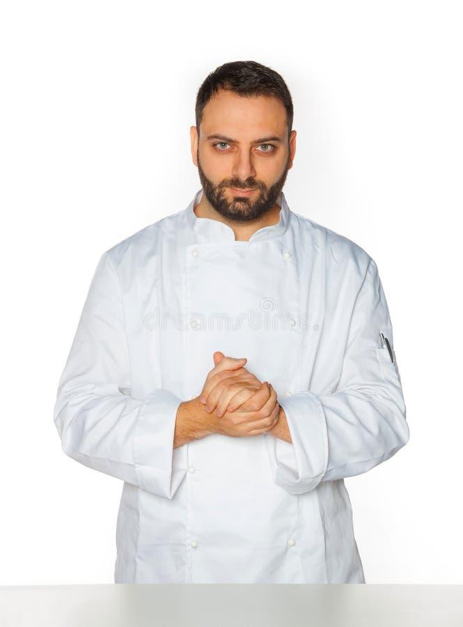 Młody szef kuchni na białym tle zdjęcie stock