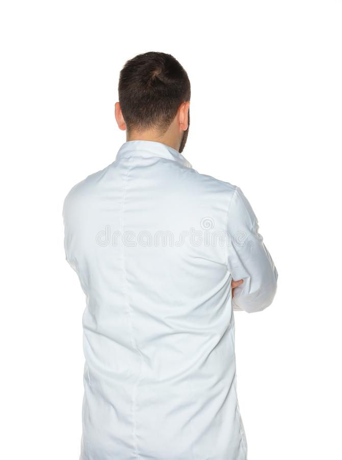 Młody szef kuchni od behind na białym tle obraz stock