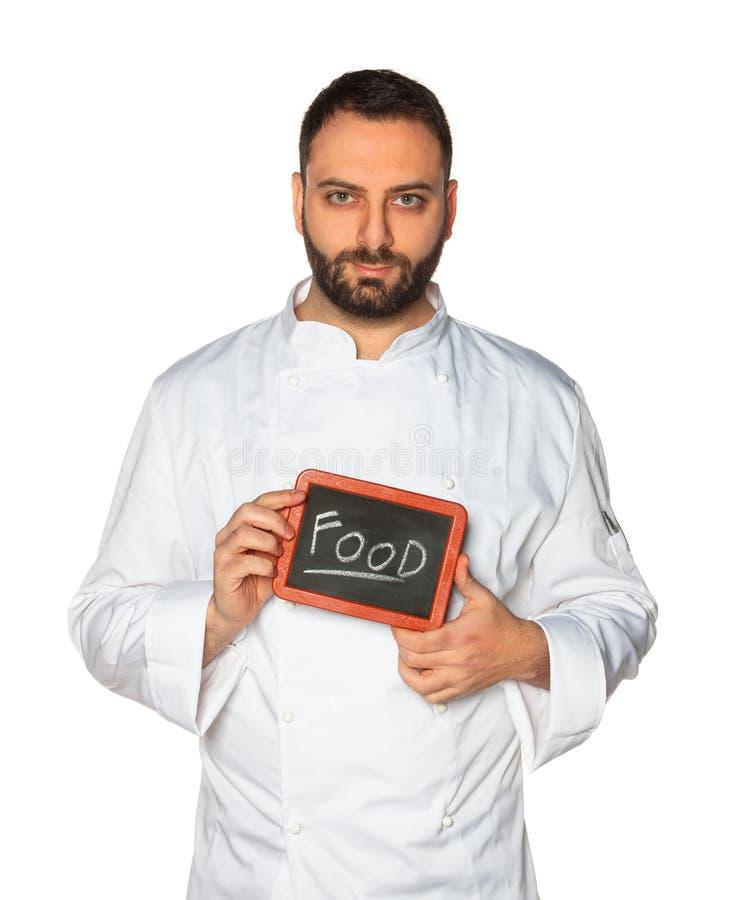 Młody szef kuchni z chalkboard zdjęcie royalty free