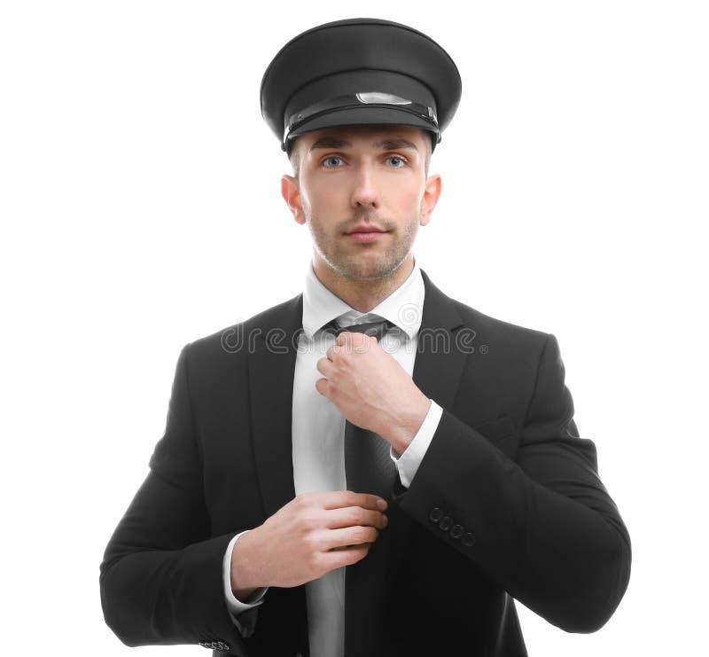 Młody szofer przystosowywa krawat na tle zdjęcie stock