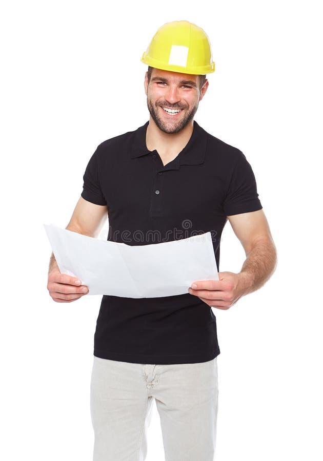 Młody uśmiechnięty inżynier trzyma projekt dokumentację obraz royalty free