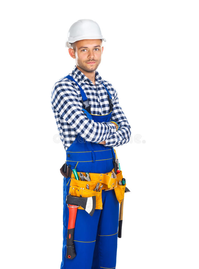 Młody ufny pracownik budowlany w munduru i narzędzia pasowym dowcipie zdjęcie stock