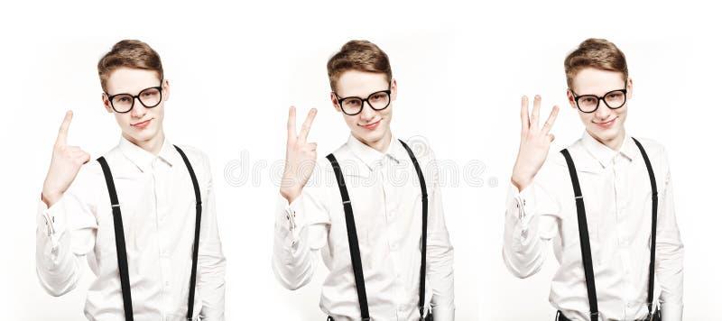 Młodych człowieków przedstawienia jeden dwa trzy palców tripple fotografia obraz royalty free