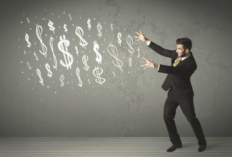Młodzi ludzie biznesu z ręka rysującymi dolarowymi znakami zdjęcia stock