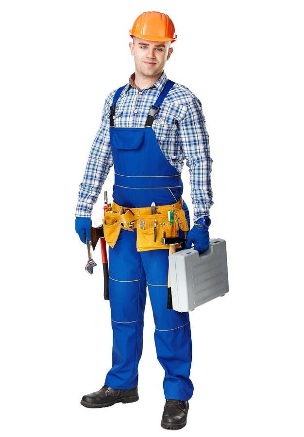 Młodzi pracowników budowlanych whis narzędzia zdjęcie royalty free