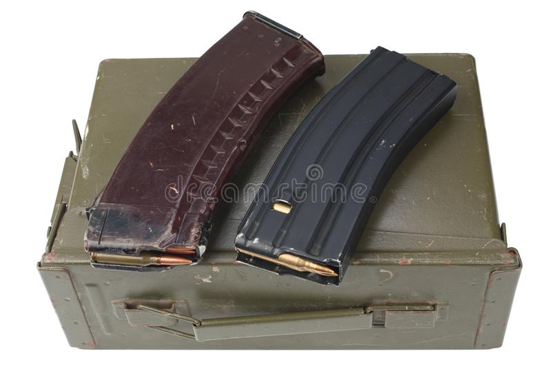 M16 and ak47 magazins on ammunition can. Isolated stock photography