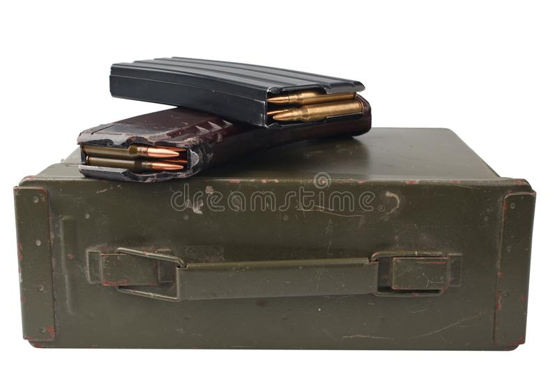 M16 and ak47 magazins on ammunition can. Isolated royalty free stock photo