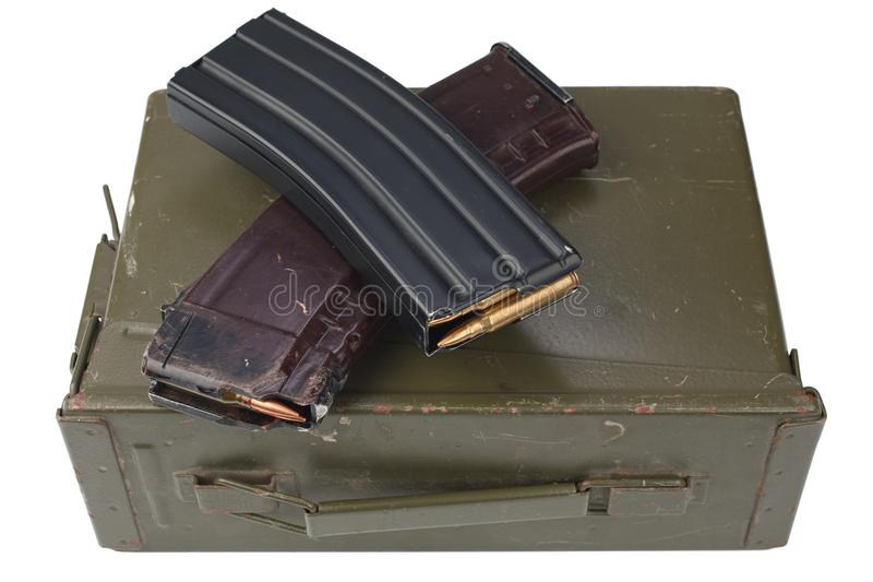 M16 and ak47 magazins on ammunition can. Isolated royalty free stock images