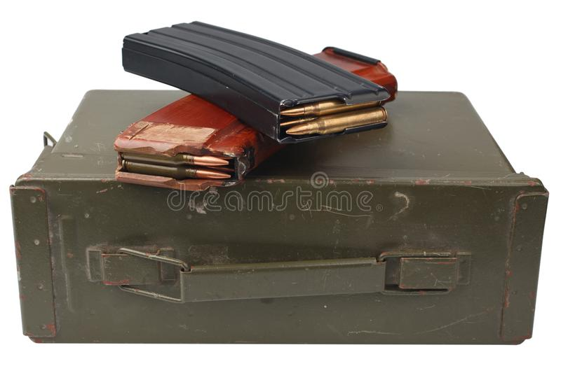M16 and ak47 magazins on ammunition can. Isolated royalty free stock image