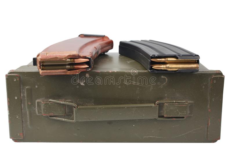 M16 and ak47 magazins on ammunition can. Isolated stock photos