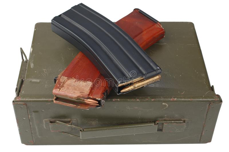 M16 and ak47 magazins on ammunition can. Isolated royalty free stock photography