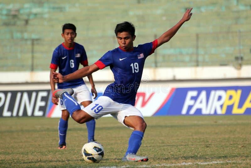 M Arif Bin Mohamed Anwar. Malaysia national U-19 football team striker, Muhammad Arif Bin Mohamed Anwar kick the ball during the match against Brunei Darussalam stock images