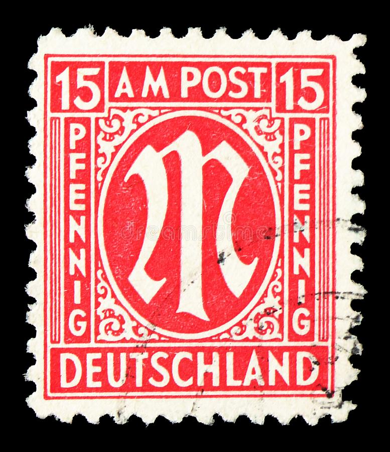 M in Circle, American and British Zone serie, circa 1945. MOSCOW, RUSSIA - JULY 19, 2019: Postage stamp printed in Germany, Allied Occupation 1945-1949 shows M royalty free stock image