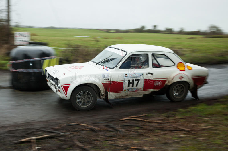 M.Creaven driving Ford Escort Mk1. GALWAY - FEBRUARY 5:M.Creaven driving Ford Escort Mk1 at annual Galway International Rally on February 5, 2012 in Galway stock images