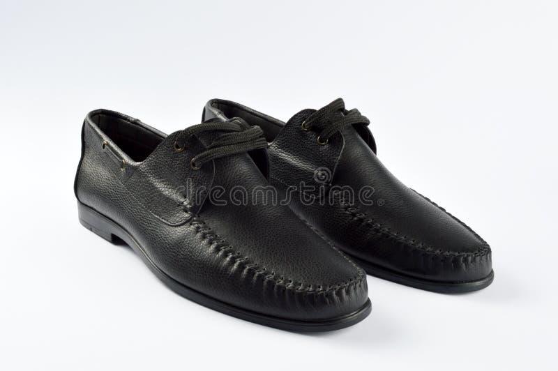 M??czyzn buty odizolowywaj?cy na bielu zdjęcie stock