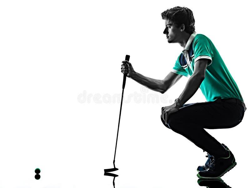 M??czyzny Golfowy golfista gra? w golfa odizolowywaj?cego cie? sylwetki bielu t?o zdjęcia stock
