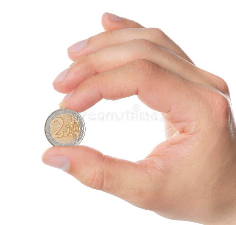 M??czyzny mienia moneta w r?ce na bia?ym tle obraz royalty free