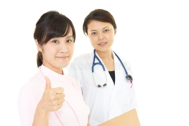 M?dico e enfermeira imagem de stock