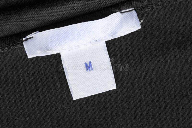 M-Größenkleidungsaufkleber lizenzfreies stockbild