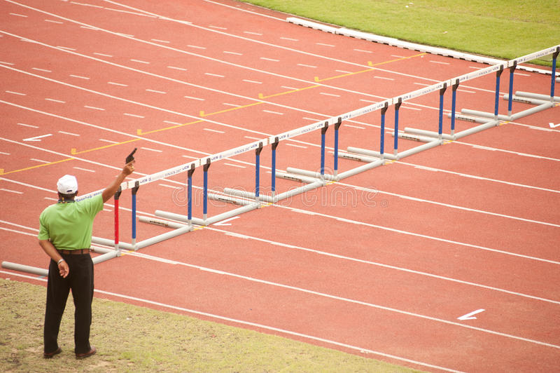 100 m. Hurdles in Thailand Open Athletic Championship 2013. PHATUMTANI,THAILAND – SEPTEMBER,6 : Committee action signal of 100 m.Hurdles in Thailand Open royalty free stock images