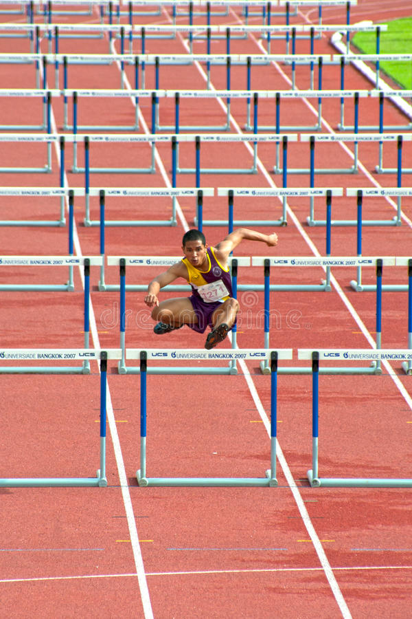 100 m. Hurdles in Thailand Open Athletic Championship 2013. PHATUMTANI,THAILAND – SEPTEMBER,6 : Men player action of 100 m.Hurdles in Thailand Open stock images