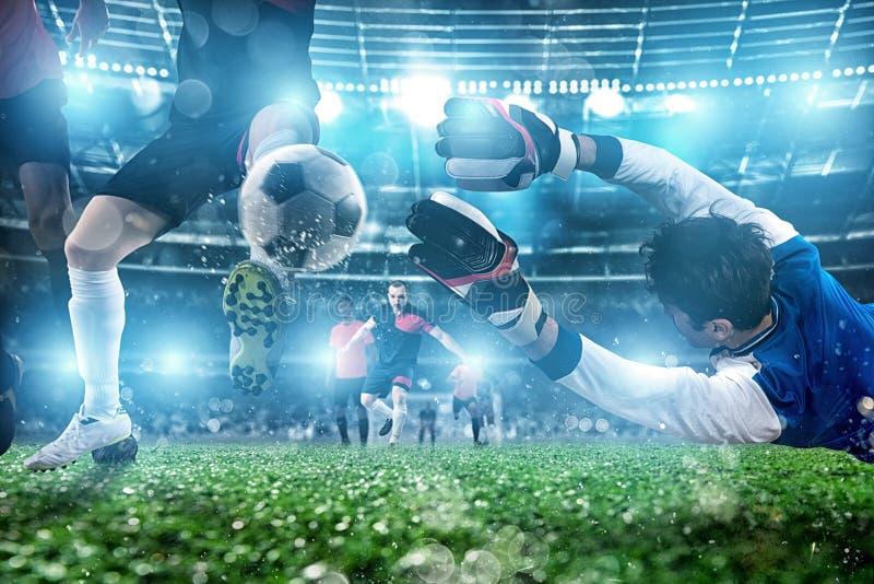 M?lvakten f?ngar bollen i stadion under en fotbolllek arkivfoton