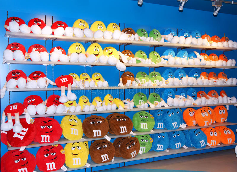 The M&M colourful soft toys. The colourful M&M gang of soft toys lined up on shelf in MMs world in Londons Leicester Square stock photo