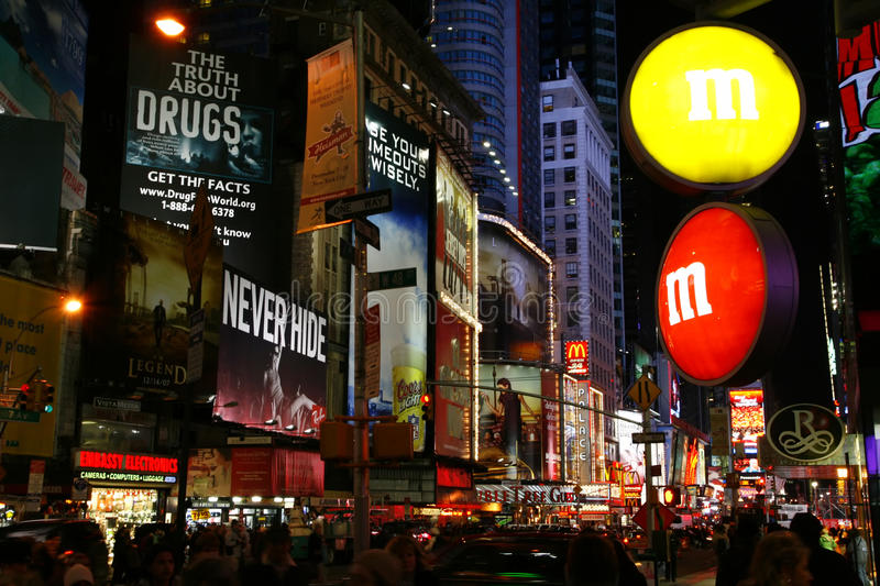 M&M Store Times Square New York City. The sign for the M&M candy store and the colorful billboards and bright lights of the Times Square area in mid-town royalty free stock image