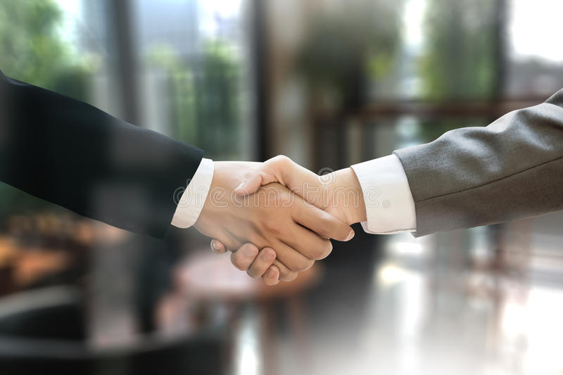 M&A (MERGERS AND ACQUISITIONS) , Businessman handshake working a stock images