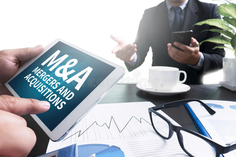 M&A (MERGERS AND ACQUISITIONS) stock photo