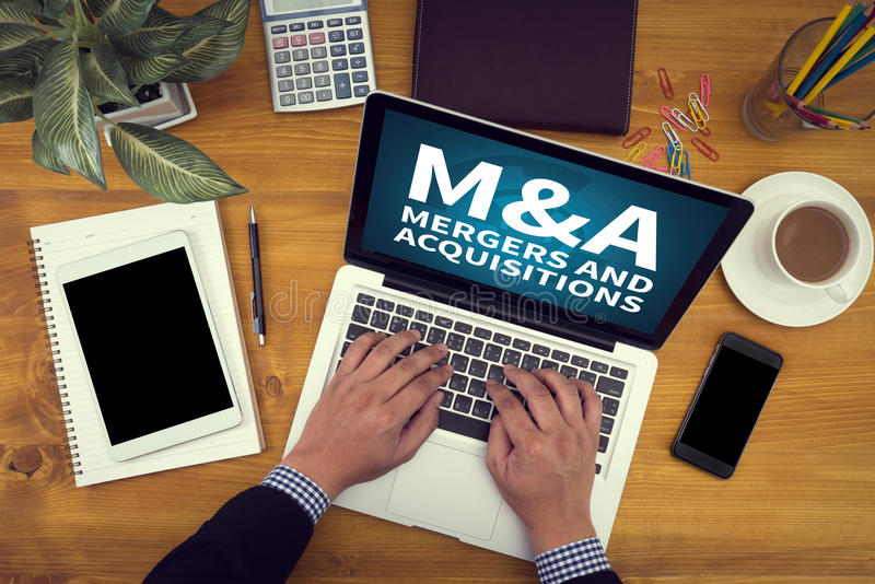 M&A (MERGERS AND ACQUISITIONS) stock image
