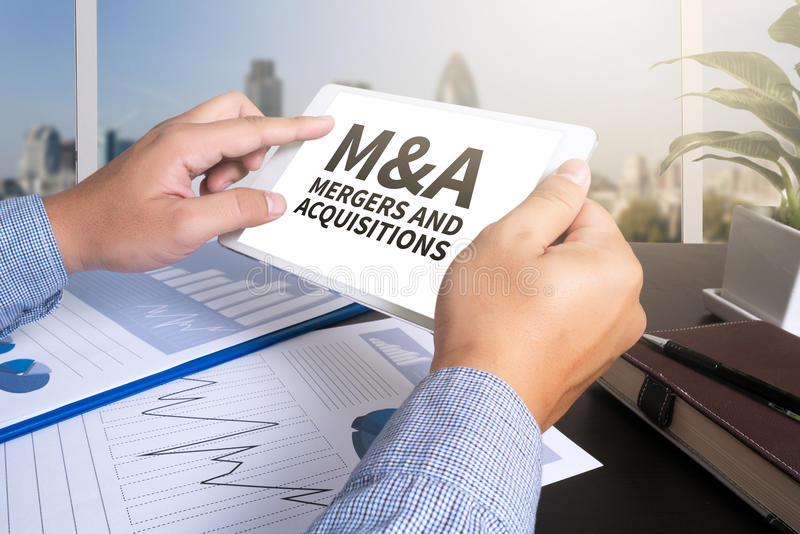 M&A (MERGERS AND ACQUISITIONS) royalty free stock photo