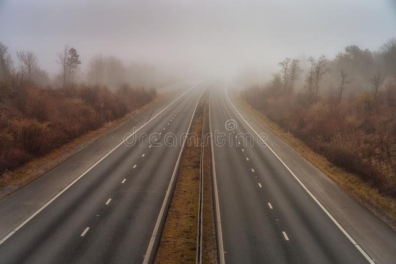 The M4 motorway in the fog. Early morning fog creating difficult driving conditions on the M4 motorway in Swansea, South Wales, UKn stock photography