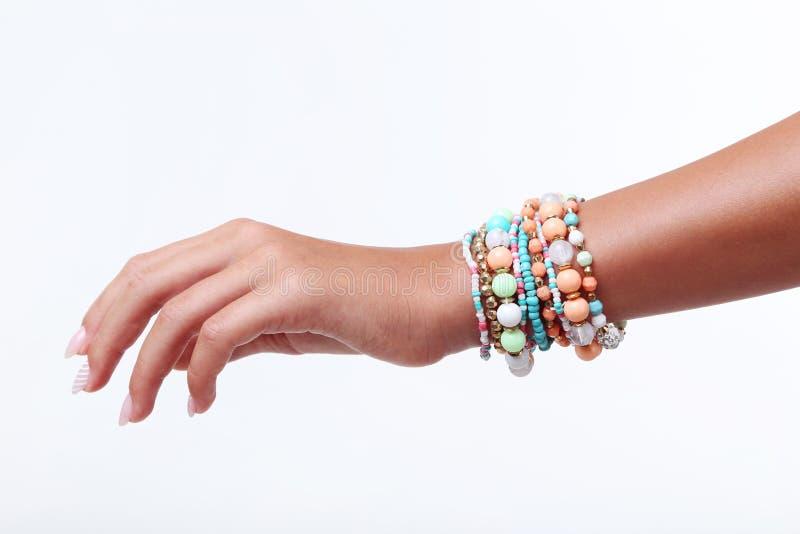 M?o com braceletes fotos de stock royalty free