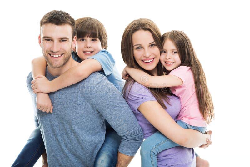 Download Młoda Rodzina Z Dwa Dzieciakami Zdjęcie Stock - Obraz złożonej z dziecko, rozochocony: 53791712