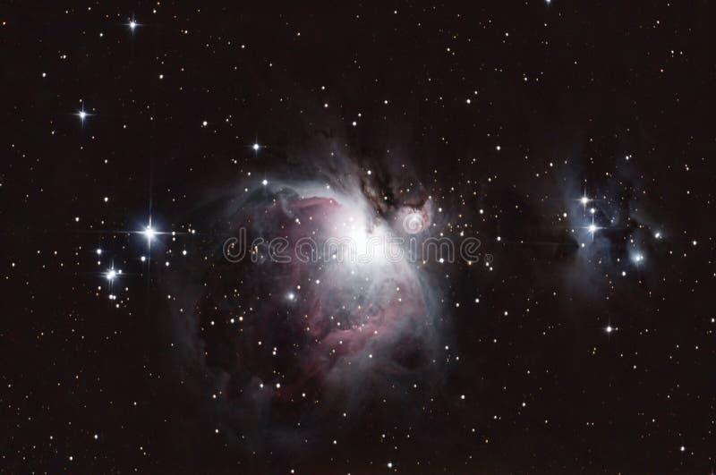 M42 - Orion Nebula und der laufende Mann lizenzfreies stockbild