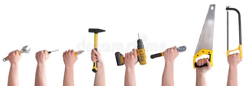 M?os com as ferramentas diferentes isoladas no fundo branco foto de stock royalty free
